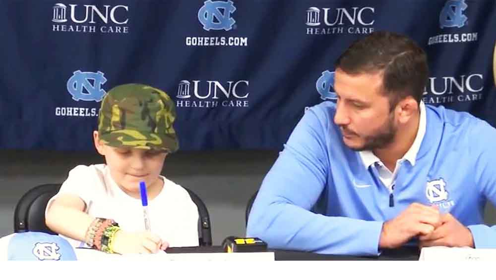 7-Year-Old Boy Battling Leukemia Signs With UNC Wrestling Team